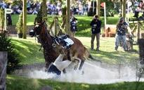 Zara Phillips takes a tumble at the Burghley horse trials - but walks away unscathed