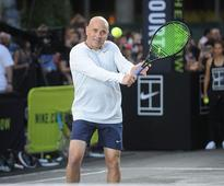 Nick Kyrgios can become No 1 if he fixes his attitude says Andre Agassi