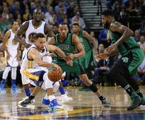 Warriors' home win streak halted by Celtics  Avery Bradley #0 and Amir Johnson #90 of the Boston Celtics try to ste...