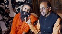 Sports Minister Vijay Goel meets Baba Ramdev for Yoga promotion