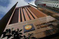 Singapore central bank probing several firms over possible securities act breaches