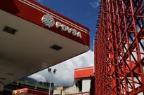 Operations at Venezuelan oil terminal halted by spill - sources