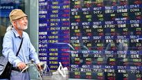 Asian shares look mixed as clarity on Trump policies eludes