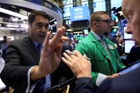 Dow hits record high as Amazon, Apple pull down S&P 500