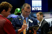 Global Markets: Stocks rise with commodities, metals, dollar