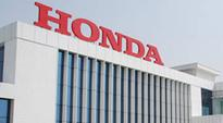 Automaker Honda invests in ride-hailing service Grab