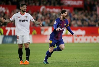 Soccer briefs: Messi to Barca's rescue; easy for Real Madrid
