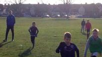 Pompey player coaches kids' park session