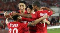 Chinese Super League: Guangzhou Evergrande seal record seventh successive title