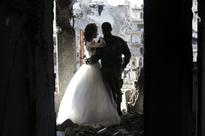 Syrian wedding photographer uses war-torn Homs as backdrop