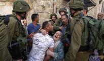 Israeli forces arrest 22 Palestinians in Al Quds, Bethlehem