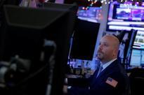 Wall Street down as oil prices slide; Fed meet in focus