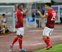 Guangzhou Evergrande reach Asia's last eight