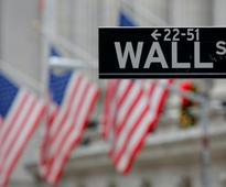 Wall Street rises sharply as rate hike fears ease; bond yields ease