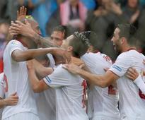 Soccer-Nzonzi strike sinks Atletico to take Sevilla top of La Liga