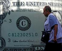 Dollar up on higher yields, euro hit by ECB's 'less for longer' decision
