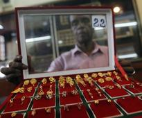 Gold steady as dollar dips, geo-political tensions simmer