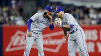 Russell Martin the infielder: Takes over at 2nd after Tulowitzki forced out of game