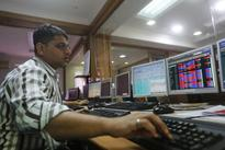 Sensex eases from record highs; Reliance Communications hits life low