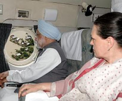 PM, Sonia survey flood-ravaged Uttarakhand