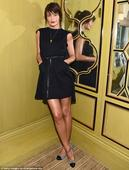 Helena Christensen displays glowing skin and gorgeous long legs in LBD for fragrance launch