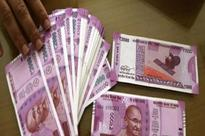 Bengal BJP leader held for carrying several lakhs in Rs 2000 notes