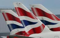 UPDATE 2-BA owner IAG trims growth plans further after Brexit vote