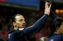 Soccer-Ibrahimovic double helps PSG sink Lyon in Cup