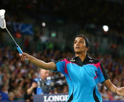 Saina, Sindhu in India Open quarters; Lin Dan, Lee Chong Wei ousted