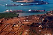 Australia trade surplus swells in February, floods a temporary setback