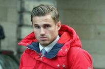 Former Dundee United footballers David Goodwillie and David Robertson judged to be rapists and ordered to pay £100,000 in damages