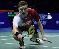 Denmark tops Indonesia to win 1st Thomas Cup b... Viktor Axelsen of Denmark hits a return against Tommy Sugiarto of Indonesia ...