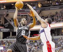 Spurs beat Wizards, Warriors win