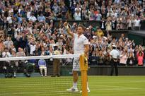 Marcus Willis drank a beer after losing to Federer at Wimbledon