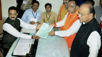 Gujarat CM Rupani files nomination, says Congress has outsourced election to three activists
