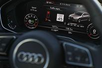 Audi debuts traffic light technology that counts down to a green light