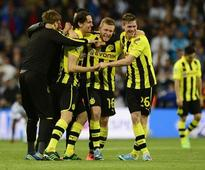 Dortmund hold on despite late Real rally