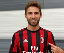 Serie A: AC Milan sign striker Fabio Borini on loan from Sunderland with option to make move permanent