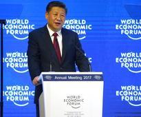 China's Xi says will not devalue renminbi or start trade war