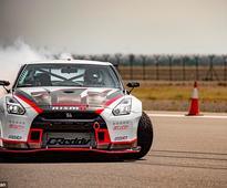 Watch Nissan's GTR break world drifting record by skidding down a runway SIDEWAYS at 190mph