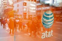 Clinton urges scrutiny of AT&T's Time Warner grab; Senate panel plans hearing