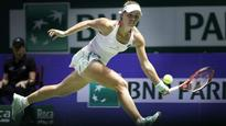 Kerber turns on the style in victory against Halep
