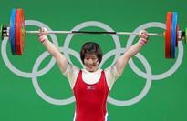 Gold at last for North Korea, Rim cheers her 'beloved Leader'