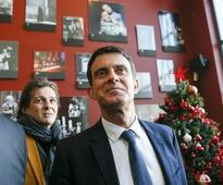 Youth wrestled to ground after slapping French ex-PM Valls