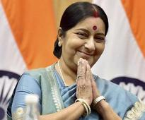 Back from Hospital, Swaraj helps Indian in US