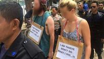 Indonesia: Walk of Shame for Australian tourists for stealing a bike