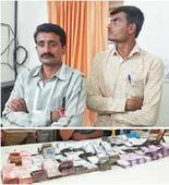 Cops seize Rs 76L in Rs 2K currency in Surat, 4 held