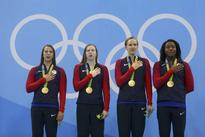 Olympic highlights from Day 8: U.S. wins 1,000th gold medal
