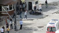 Blast kills 2 officers near police HQ