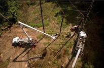 Helicopters used to conduct forestry inspections in JCP&L power transmission line corridors